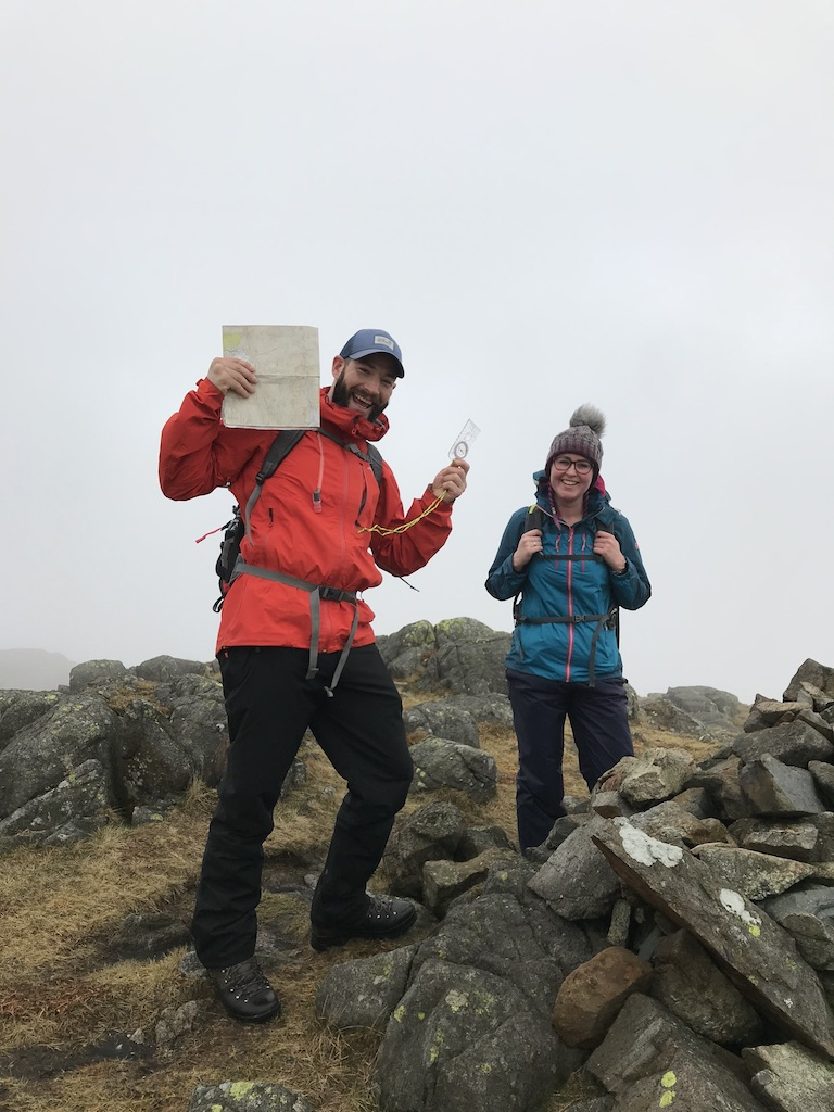 Two walkers celebrate as they reach the summit