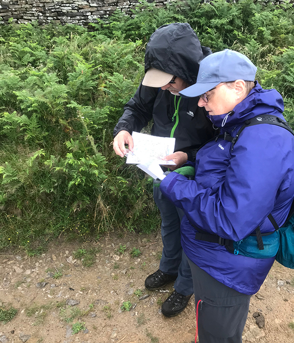 Photo of two people consulting an OS map